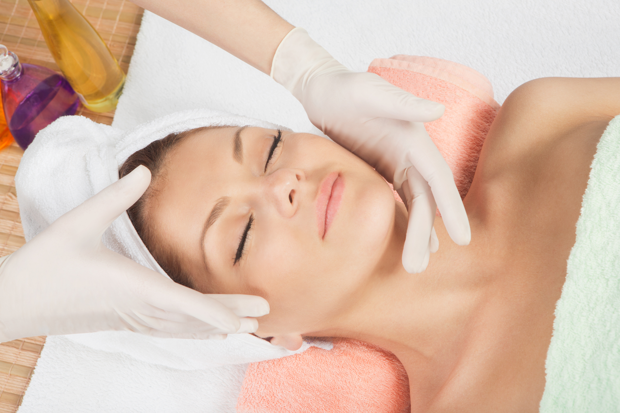 relaxed woman enjoying facial
