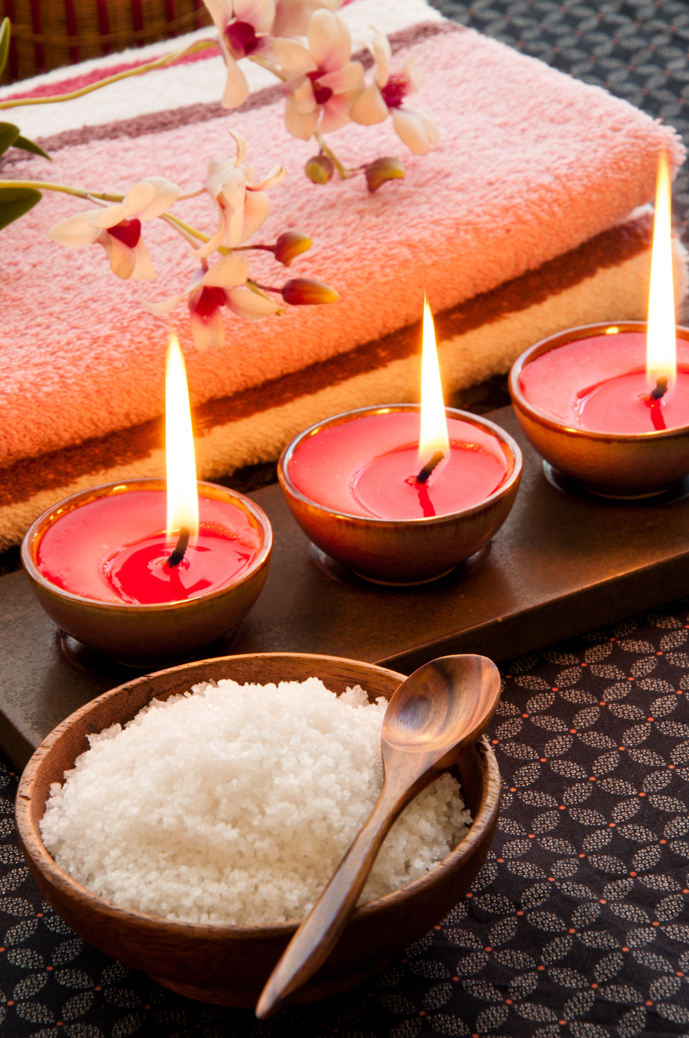 all natural sea salts with clean towels and candles
