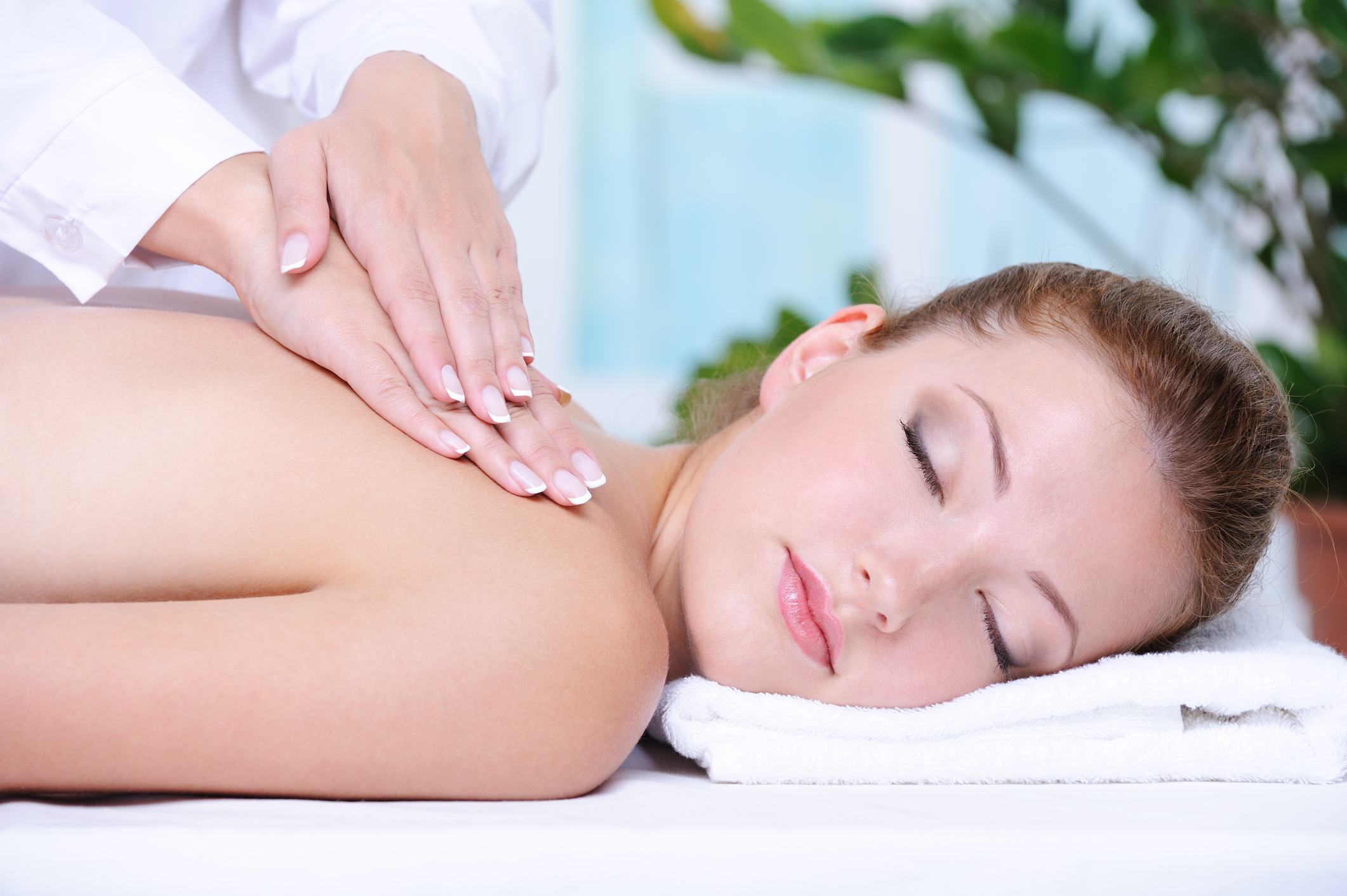 Woman enjoying light pressure massage