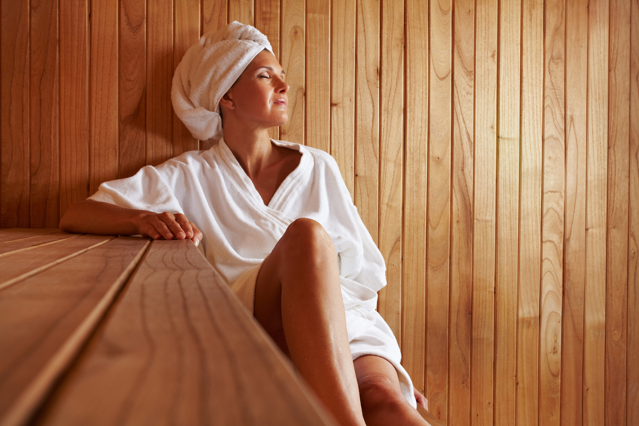 Woman in infrared sauna session for Detox Packages