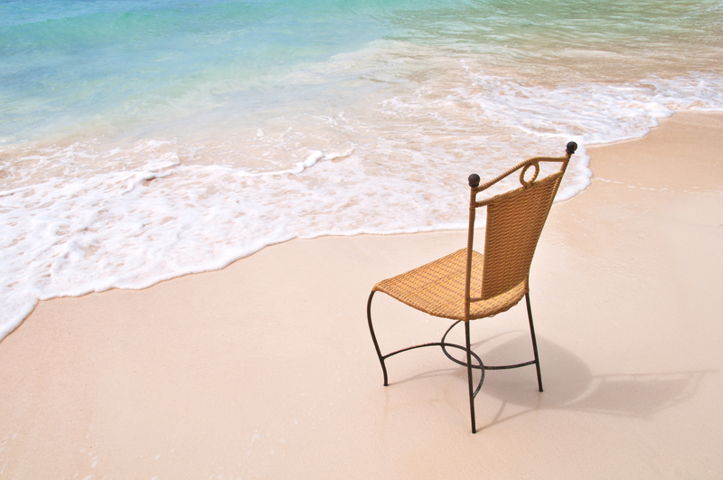 depression a lone chair on beach